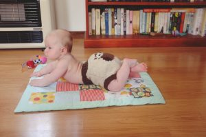 T's night time nappy – a terry-towel flat with bamboo booster and a wool cover.